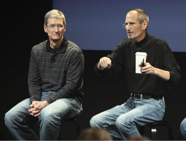 File photo shows Apple COO Cook  and CEO Jobs during a news conference in Cupertino