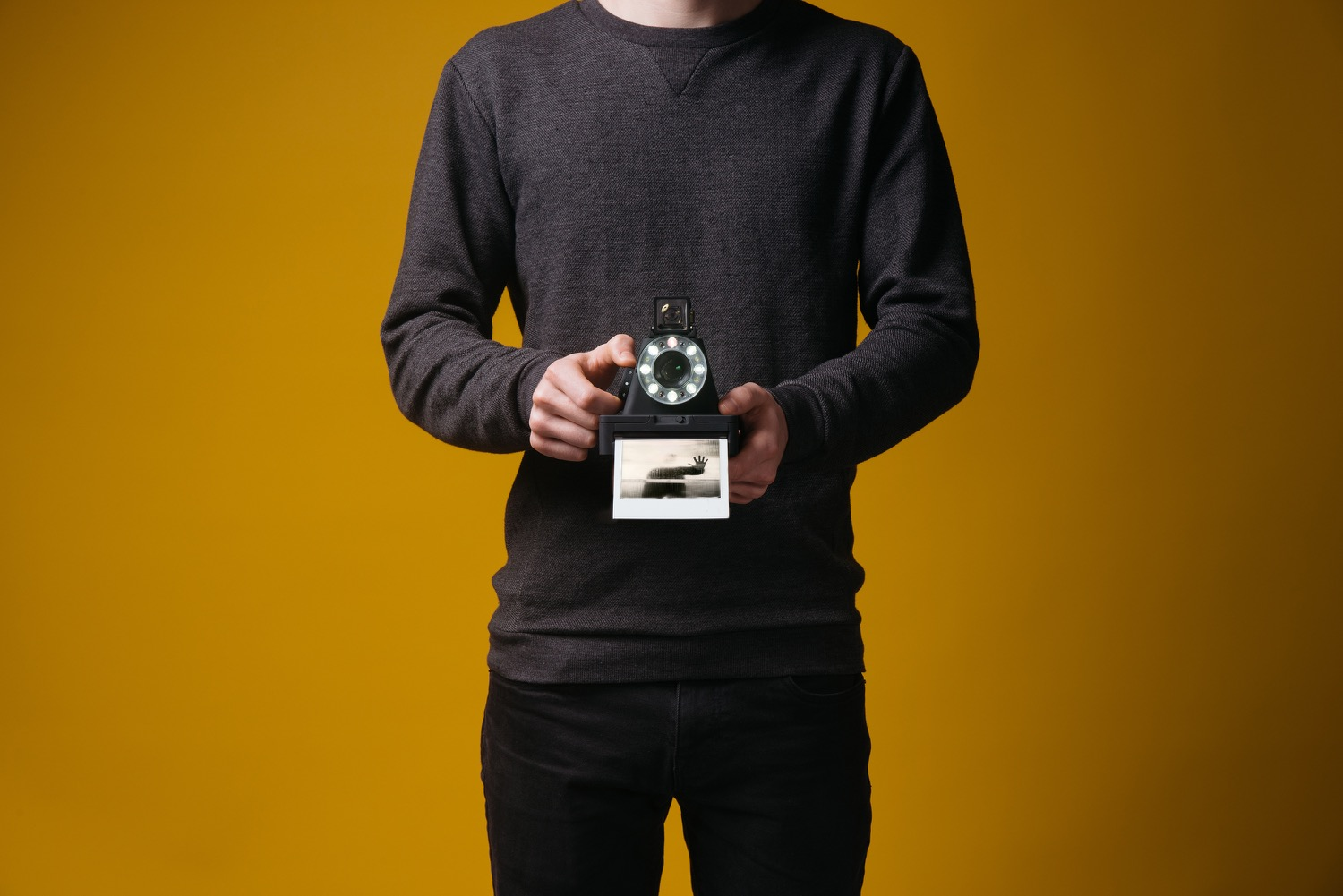 12-Holding-Camera-Front-YELLOW-3000px_1500