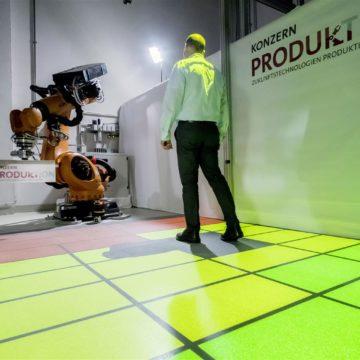 Persone e robot industriali lavorano insieme, senza barriere rigide. Un essere umano può muoversi in modo assolutamente sicuro nelle vicinanze di un robot industriale senza esserne separato da una barriera di sicurezza fissa. Ciò è possibile grazie allo scanner laser di sicurezza.