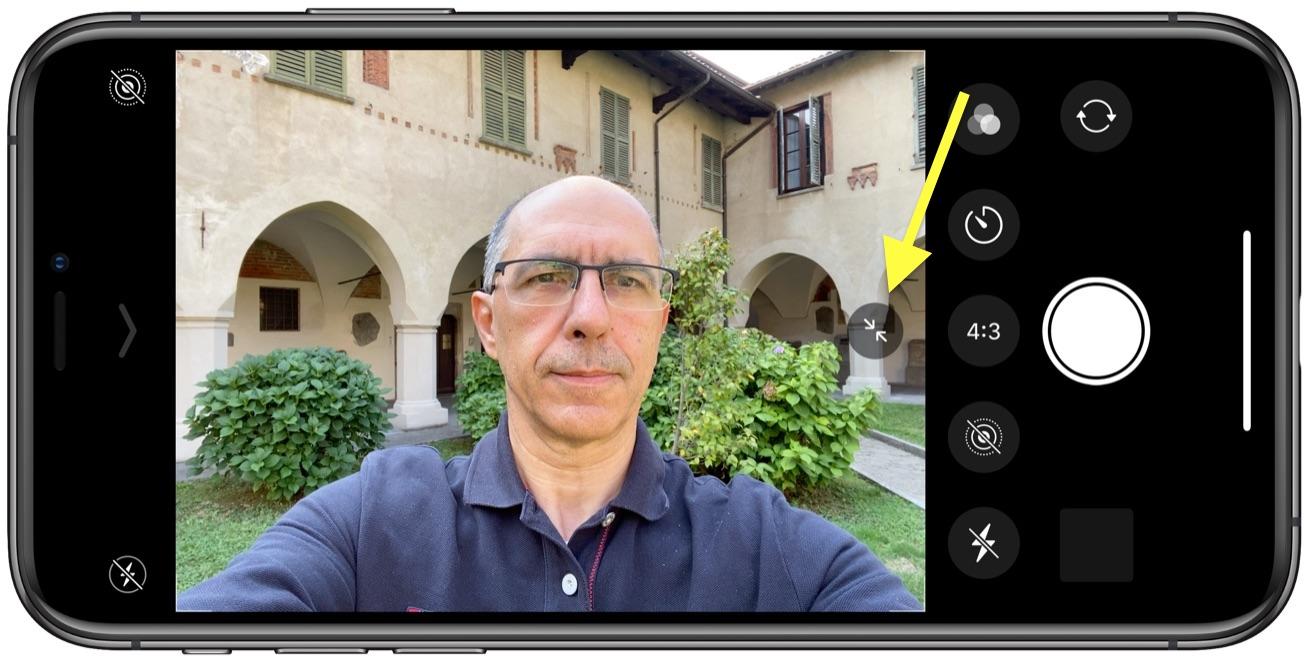 La freccia gialla indica l'icona per modificare la focale in iPhone 11 Pro